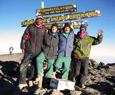 Lucinda Roenicke on the summit of Kilimanjaro, 7summits.com Expeditions